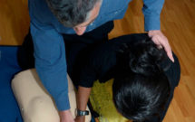 Mick, AAA trainer, with Paulette Ellis, new recruit, training First Aid
