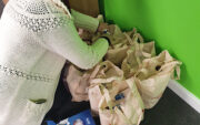 Notaro Homecare Ltd team member filling bags with essential items