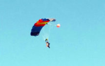 Kelly parachuting during skydive